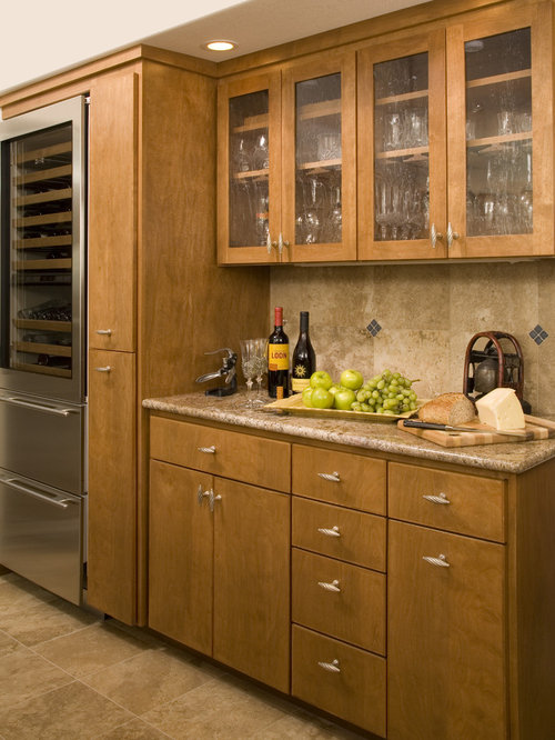 Elegant kitchen photo in Denver with flat-panel cabinets, stainless ...