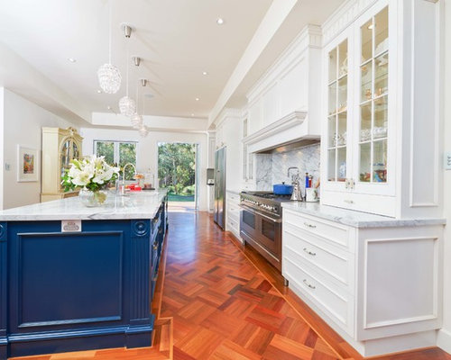 Inspiration For A Timeless Galley Kitchen Remodel In Brisbane With  Glass Front Cabinets, Blue