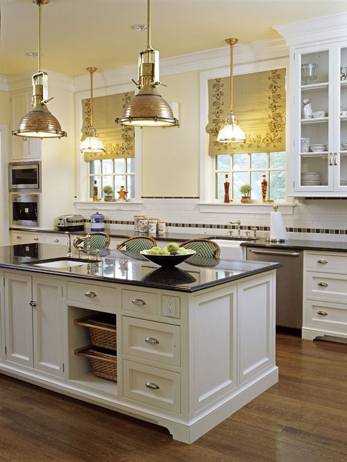Beautiful Mid Sized Elegant U Shaped Medium Tone Wood Floor Enclosed Kitchen Photo In  Santa