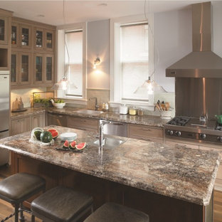 Charmant Elegant L Shaped Kitchen Photo In Cincinnati With Glass Front Cabinets,  Stainless Steel