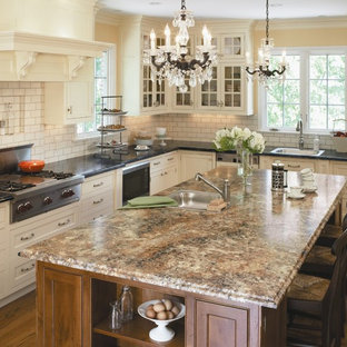 Example of a classic l-shaped kitchen design in Cincinnati with beaded inset cabinets, stainless steel appliances, a drop-in sink, white cabinets, laminate countertops, white backsplash and subway tile backsplash