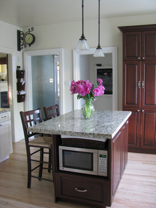 Traditional Kitchen Idea In Toronto With Raised Panel Cabinets And Dark  Wood Cabinets Part 80