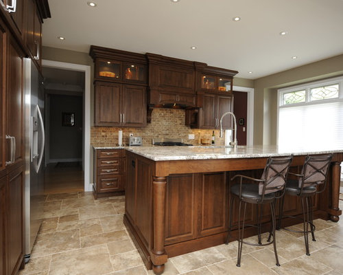 elegant kitchen photo in other with raisedpanel cabinets dark wood cabinets beige