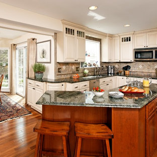 Wrap Around Island Seating Example Of A Clic L Shaped Medium Tone Wood Floor Eat In Kitchen Design
