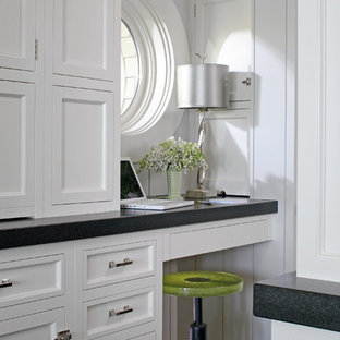 This is an example of a victorian kitchen in Other with recessed-panel cabinets and white cabinets.