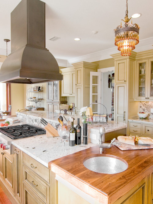 Kitchen - traditional kitchen idea in Other with beaded inset cabinets,  wood countertops and an