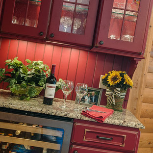 Large traditional open concept kitchen photos - Large elegant l-shaped medium tone wood floor open concept kitchen photo in Other with stainless steel appliances, an island, a farmhouse sink, raised-panel cabinets, red cabinets and red backsplash