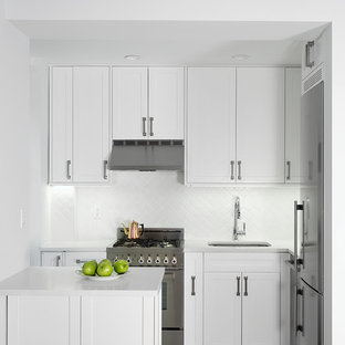 Small transitional enclosed kitchen appliance - Small transitional l-shaped porcelain floor enclosed kitchen photo in New York with an undermount sink, white cabinets, quartz countertops, white backsplash, subway tile backsplash, stainless steel appliances, shaker cabinets and a peninsula