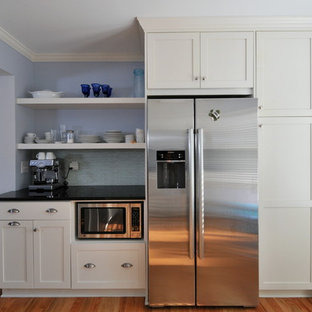 Traditional kitchen pictures - Inspiration for a timeless kitchen remodel in Atlanta with stainless steel appliances, shaker cabinets, white cabinets, blue backsplash and matchstick tile backsplash