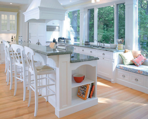 Inspiration for a timeless kitchen remodel in Other with paneled appliances  and white cabinets