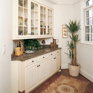 Inspiration for a traditional kitchen in Other with glass-front cabinets and beige cabinets.