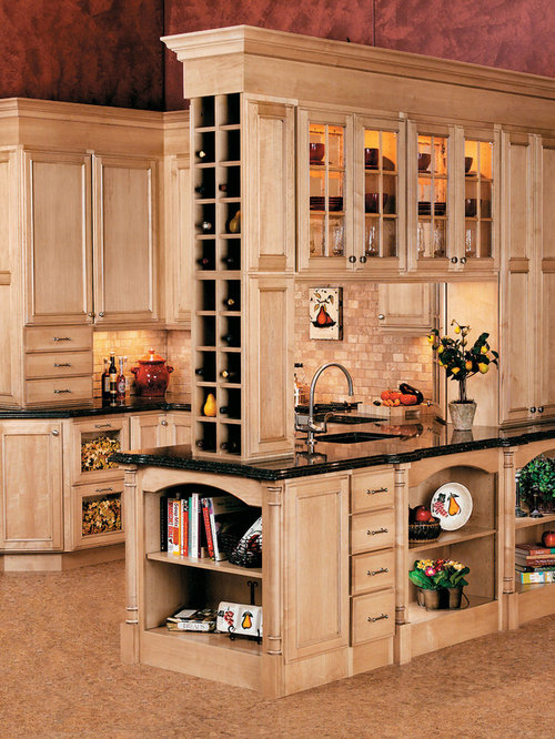 example of a classic kitchen design in other with cabinets light wood