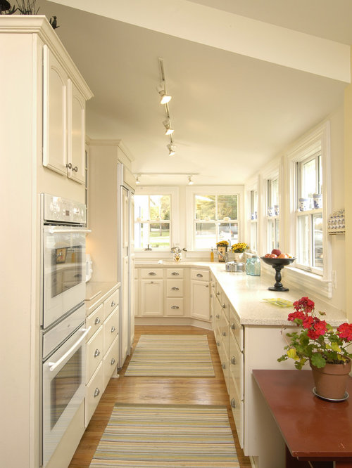 traditional enclosed kitchen idea in dc metro with white appliances