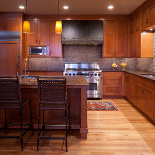 Traditional kitchen ideas - Elegant kitchen photo in Minneapolis with a double-bowl sink, shaker cabinets, medium tone wood cabinets, paneled appliances and mosaic tile backsplash