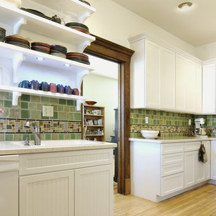 Mid-sized traditional enclosed kitchen ideas - Mid-sized elegant l-shaped light wood floor enclosed kitchen photo in Other with white appliances, open cabinets, white cabinets, green backsplash, an undermount sink, ceramic backsplash and no island