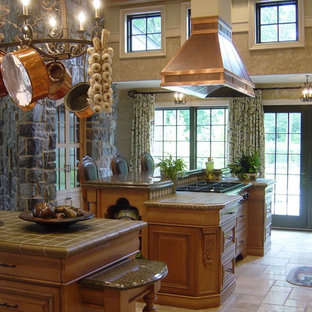 Large traditional enclosed kitchen designs - Example of a large classic enclosed kitchen design in New York with raised-panel cabinets, medium tone wood cabinets, tile countertops, stainless steel appliances, a farmhouse sink and green backsplash