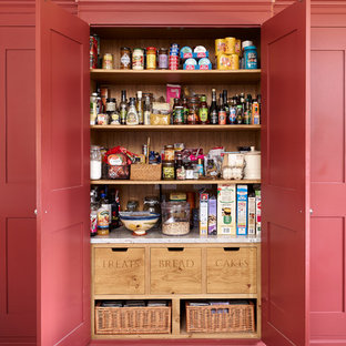 Design ideas for a farmhouse kitchen pantry in Other with recessed-panel cabinets and red cabinets.
