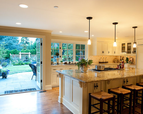 Large Traditional L Shaped Dark Wood Floor Open Concept Kitchen Idea In  Seattle With Recessed