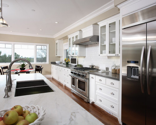 Example Of A Classic Kitchen Design In San Francisco With Glass Front  Cabinets And Stainless