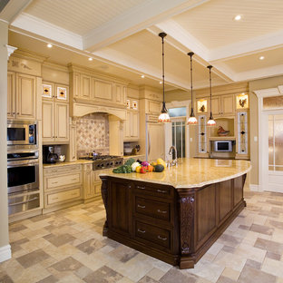 Inspiration for a large traditional l-shaped kitchen pantry in Atlanta with an undermount sink, raised-panel cabinets, black cabinets, marble benchtops, beige splashback, porcelain splashback, stainless steel appliances, terra-cotta floors, with island and multi-coloured floor.