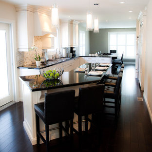 Traditional eat-in kitchen inspiration - Inspiration for a timeless eat-in kitchen remodel in Toronto with recessed-panel cabinets, white cabinets and multicolored backsplash