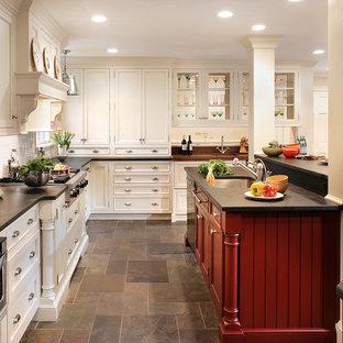 Kitchen - traditional slate floor kitchen idea in Newark with stainless steel appliances