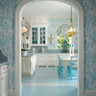 Inspiration for a traditional eat-in kitchen in Miami with recessed-panel cabinets, white cabinets and blue splashback.