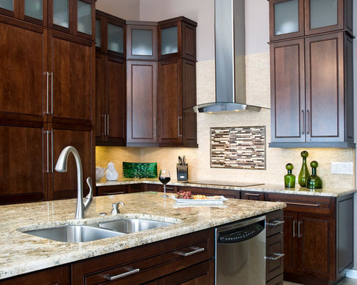 example of a classic kitchen design in san diego with granite countertops and stainless steel appliances