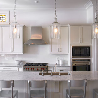 Traditional kitchen photos - Kitchen - traditional kitchen idea in New Orleans with shaker cabinets and marble countertops