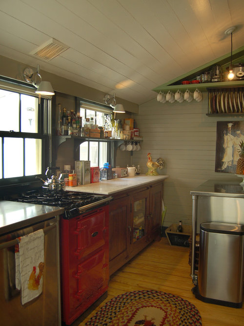 Good Mountain Style Enclosed Kitchen Photo In Austin With Colored Appliances And  Marble Countertops