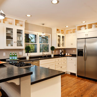 Traditional kitchen with stainless steel, hardwood floors, and granite counterto