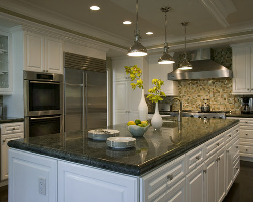 Elegant Kitchen Photo In Orange County With Raised Panel Cabinets Stainless Steel Appliances