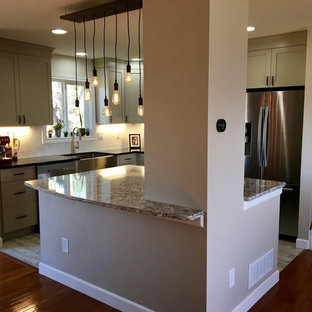 Inspiration for a small country l-shaped open plan kitchen in Denver with a farmhouse sink, shaker cabinets, beige cabinets, quartz benchtops, white splashback, ceramic splashback, stainless steel appliances, vinyl floors and with island.