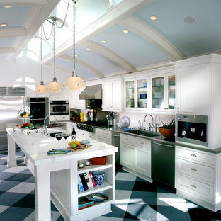Elegant galley kitchen photo in Newark with stainless steel appliances, a single-bowl sink, recessed-panel cabinets and white cabinets