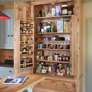 Photo of a large classic kitchen pantry in Other with a submerged sink, beaded cabinets, granite worktops, ceramic flooring and an island.