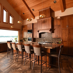Design ideas for a large rustic l-shaped open plan kitchen in Seattle with a submerged sink, shaker cabinets, medium wood cabinets, granite worktops, multi-coloured splashback, glass tiled splashback, integrated appliances, ceramic flooring, an island and multi-coloured floors.