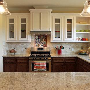Mid-sized southwestern eat-in kitchen pictures - Mid-sized southwest u-shaped eat-in kitchen photo in Austin with beige backsplash, terra-cotta backsplash and a peninsula
