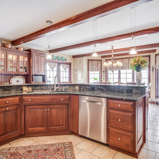 Huge traditional eat-in kitchen designs - Example of a huge classic l-shaped ceramic floor and beige floor eat-in kitchen design in Chicago with a drop-in sink, raised-panel cabinets, medium tone wood cabinets, granite countertops, red backsplash, brick backsplash, stainless steel appliances, an island and black countertops
