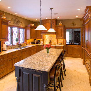 Large traditional u-shaped eat-in kitchen in Other with a double-bowl sink, raised-panel cabinets, medium wood cabinets, granite benchtops, beige splashback, ceramic splashback, black appliances, ceramic floors and with island.