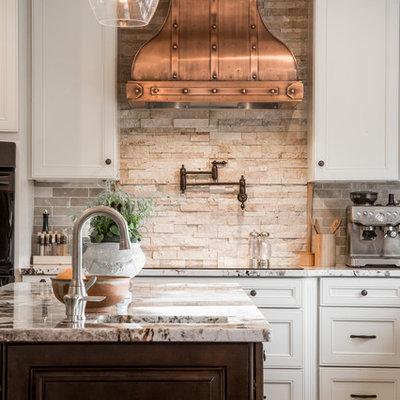 Kitchen - traditional kitchen idea in Tampa with beige backsplash and stone tile backsplash