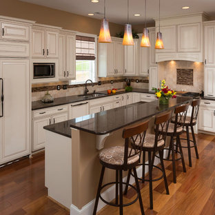 Example of a classic kitchen design in DC Metro with paneled appliances
