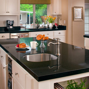 Traditional white kitchen with black tops