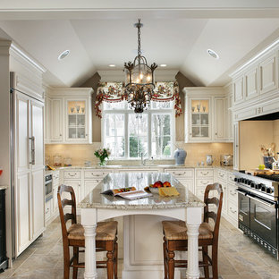 Inspiration for a timeless u-shaped limestone floor enclosed kitchen remodel in New York with an undermount sink, beaded inset cabinets, beige cabinets, granite countertops, beige backsplash, an island and paneled appliances