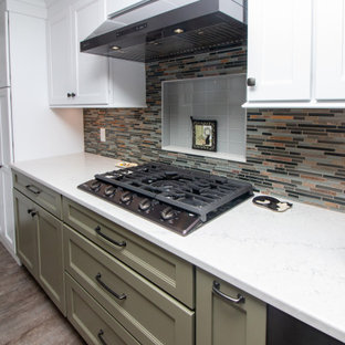 Large traditional eat-in kitchen ideas - Inspiration for a large timeless u-shaped vinyl floor and gray floor eat-in kitchen remodel in Boston with a single-bowl sink, shaker cabinets, white cabinets, quartz countertops, multicolored backsplash, glass sheet backsplash, stainless steel appliances, a peninsula and white countertops
