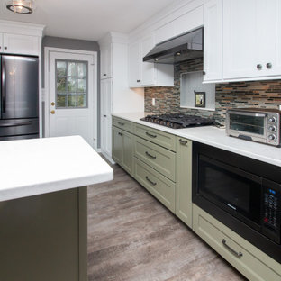 Large traditional eat-in kitchen ideas - Eat-in kitchen - large traditional u-shaped vinyl floor and gray floor eat-in kitchen idea in Boston with a single-bowl sink, shaker cabinets, white cabinets, quartz countertops, multicolored backsplash, glass sheet backsplash, stainless steel appliances, a peninsula and white countertops