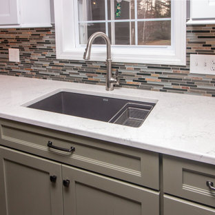 Large traditional eat-in kitchen appliance - Example of a large classic u-shaped vinyl floor and gray floor eat-in kitchen design in Boston with a single-bowl sink, shaker cabinets, white cabinets, quartz countertops, multicolored backsplash, glass sheet backsplash, stainless steel appliances, a peninsula and white countertops