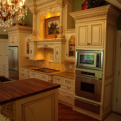 traditional kitchen by V3 Studios Inc