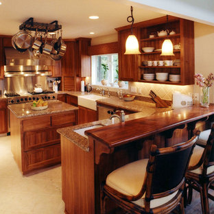 Tropical kitchen designs - Inspiration for a tropical kitchen remodel in Hawaii with a farmhouse sink, open cabinets and medium tone wood cabinets