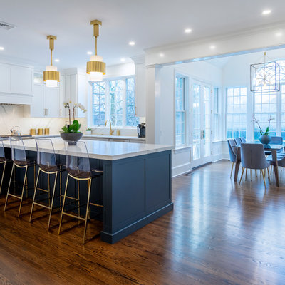 Large transitional dark wood floor and brown floor kitchen photo in Philadelphia with an undermount sink, shaker cabinets, white cabinets, quartz countertops, white backsplash, quartz backsplash, stainless steel appliances, an island and white countertops