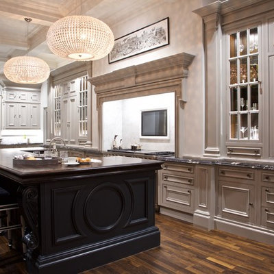 Large elegant l-shaped dark wood floor and brown floor eat-in kitchen photo in Glasgow with a farmhouse sink, recessed-panel cabinets, gray cabinets, marble countertops, white backsplash, marble backsplash, stainless steel appliances, an island and multicolored countertops